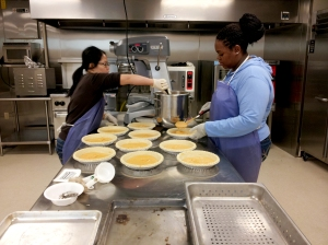 Cooking sweet potato pies in UAPB Experimental Kitchen