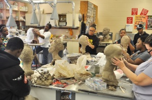 UAPB art students use their skills to sculpt a bust from the live model, Stephanie Weathers. (University of Arkansas at Pine Bluff/Marchello Eans)