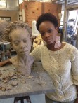 Stephanie Weathers pose with her clay bust by Basil Watson (University of Arkansas at Pine Bluff/Danny Campbell)
