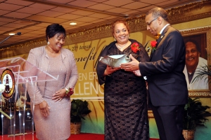 Dr. Margaret Martin-Hall, director of Development presents an award to UAPB Chancellor Dr. Laurence B. Alexander and his wife, Veronica during the 2014 Chancellor's Benefit for the Arts.