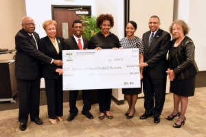 (L-R): Mr. Ellis Bell, Founder/President of Bell Community Foundation and Ms. Catherine Coleman, Board Member for Bell Community Foundation, present a check for $16,542 to benefit UAPB Animal Science students Maleek Ware, Azia Pugh-Thomas, and Ashlyn Carlton. UAPB Chancellor Dr. Laurence B. Alexander and Dr. Mary E. Benjamin, vice chancellor for Research, Innovation, and Economic Development were also present to lend their support.