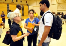 Cutline for photo: Chicago Heights, IL native Elijah Maldonado and his mother, Casandra talk with Dr. Linda Okiror, vice chancellor for enrollment management after the opening ceremony for the LIONS program. More than 200 students are enrolled in this year's program.
