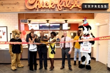 Student Government Association President Milae Wilson, UAPB Chancellor Dr. Laurence B. Alexander, and Miss University of Arkansas at Pine Bluff Ashleigh Tate cut the ribbon during the grand opening of Chick fil-A Express in the L.A. Davis, Sr. Student Union. They are joined by (l-r) the Golden Lion Mascot, John Inman, Regional Director of Thompson Hospitality, Chick fil-A executive Dwayne Gray, and the Chick fil-A cow mascot. Photo by Richard Redus.