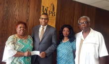 Cutline for photo: Rose Pridgeon Vaughan (far left) presented a $1,000 check to UAPB Chancellor Dr. Laurence B. Alexander (second from left) to benefit the David Vaughan Performing Arts Scholarship. She is accompanied by her daughter, Kellie Vaughan Noble, and husband, Edward Earl Vaughan (far right). The scholarship is awarded each year to a black male at UAPB majoring in theater. Photo by Tisha D. Arnold